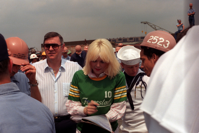 Actress Ann Jillian signs autographs after a 30-minute show with Bob Hope on board the aircraft carrier USS FORRESTAL (CV 59)