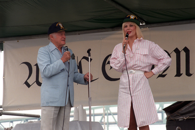 Bob Hope and actress Ann Jillian entertain sailors and shipyard workers during a 30-minute show on board the aircraft carrier USS FORRESTAL (CV-59)