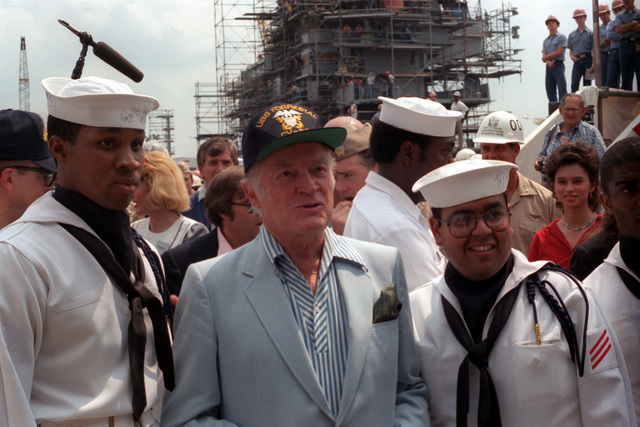 Bob Hope meets with sailors after a 30-minute show with actress Ann Jillian on board the aircraft carrier USS FORRESTAL (CV-59)