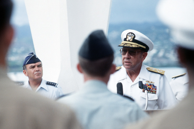 Admiral (ADM) William J. Crowe, commander in chief, US Pacific Command, speaks at a re-enlistment ceremony held on the USS ARIZONA Memorial as US Air Force General (GEN) Jerome O'Malley (left), commander in chief, US Pacific Forces, listens