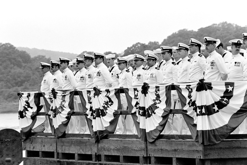 Crewmen stand in formation on a platform aboard the nuclear-powered attack submarine USS HYMAN G. RICKOVER (SSN 709) during the ship's commissioning ceremony at General Dynamics Electric Boat Division