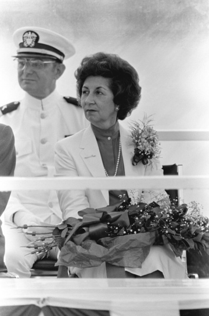 Retired Commander Eleonore B. Rickover, sponsor, attends the commissioning ceremony for the nuclear-powered attack submarine USS HYMAN G. RICKOVER (SSN 709) at General Dynamics Electric Boat Division. Mrs. Rickover is the wife of the ship's namesake. Seated in the background is Lieutenant Commander James M. Leone, Chaplain Corps