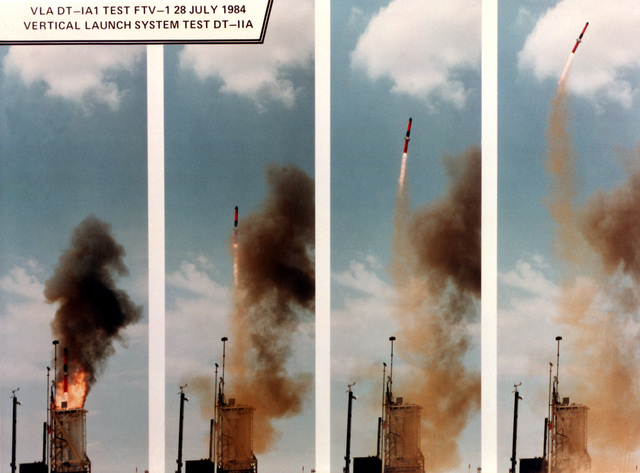Naval Weapons Center. A series of four view as a Vertical Launch ASROC (VLA) missile is fired from its Vertical Launch System (VLS) during tests