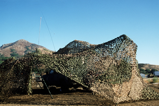 A camouflaged AN/TRC-38 microwave communications van in operation during Exercise Gallant Eagle '84