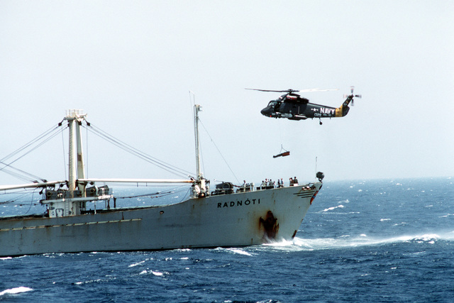 A left side view of an SH-2F Seasprite light airborne multipurpose system (LAMPS) helicopter. Members of Light Helicopter Anti-submarine Squadron 30 (HSL 30) are using the Seasprite to airlift a heart attack victim from the Hungarian freighter RADNOTI during Operation INTENSE LOOK