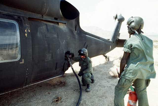 A UH-60 Black Hawk (Blackhawk) helicopter undergoes hot refueling at a fuel depot during Exercise GALLANT EAGLE '84