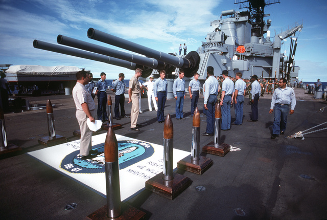 A working uniform rehearsal of sideboys and a Marine honor guard is conducted aboard the battleship USS IOWA (BB 61), prior to the arrival of President Jose Napolean Duarte of El Salvador