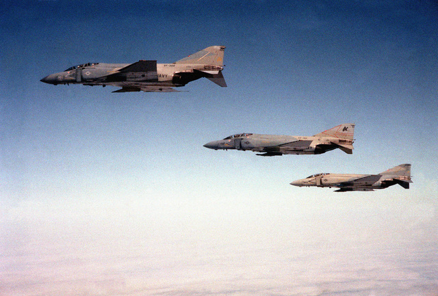 An air-to-air left side view of two F-4S Phantom II aircraft. They are assigned to Fighter Squadrons 301 and 302 (VF-301, 302)