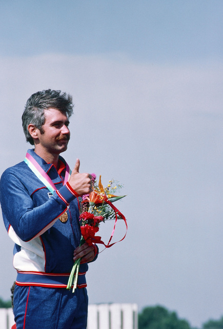 Army Captian Edward F. Etzel, center, after receiving a gold medal in the small-bore rifle English competition at the 1984 Summer Olympics. He scored 599 points out of a possible 600