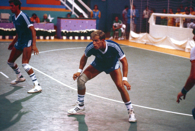 Army First Lieutenant Peter Lash, center, competes in a team handball match during the 1984 Summer Olympics