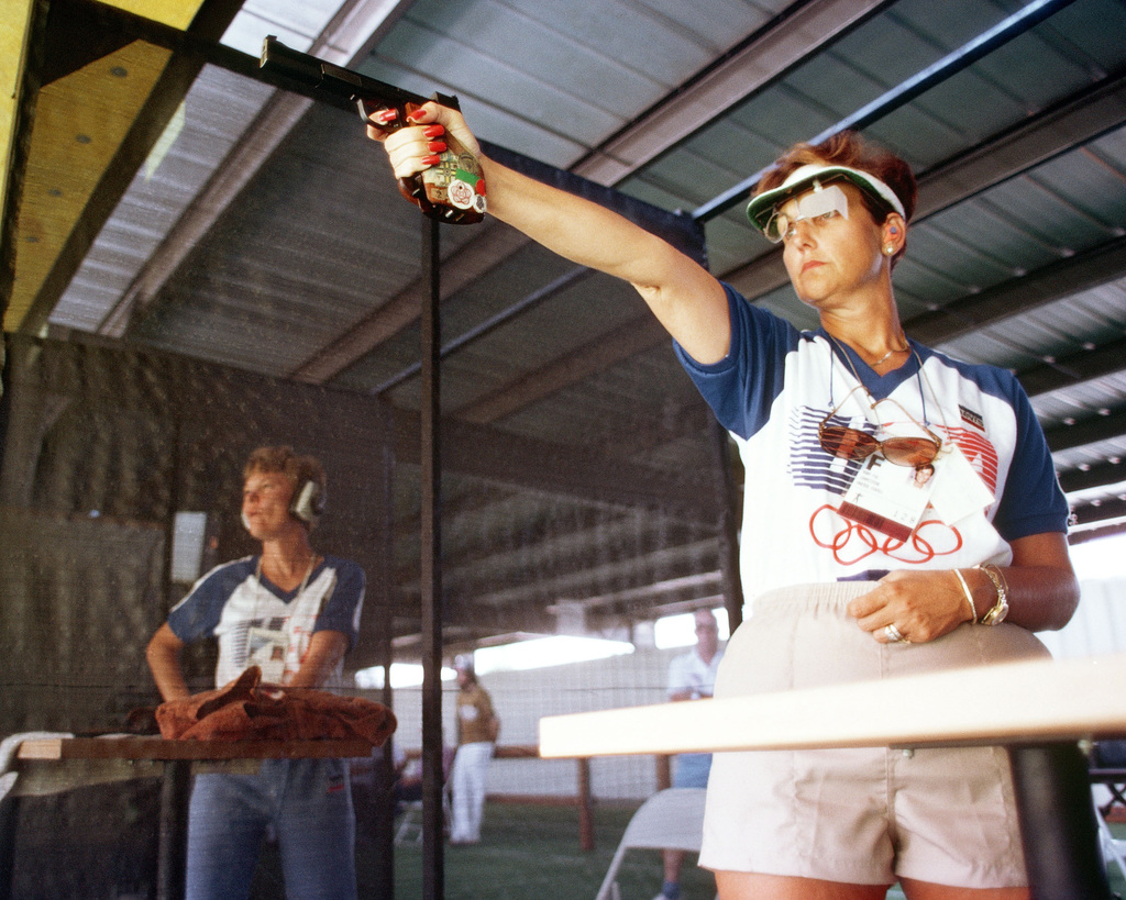 Army SPECIALIST 5 Ruby E. Fox from Parker, Arizona, participates in the sport pistol competition at the 1984 Summer Olympics. She won a silver medal for her performance in the event