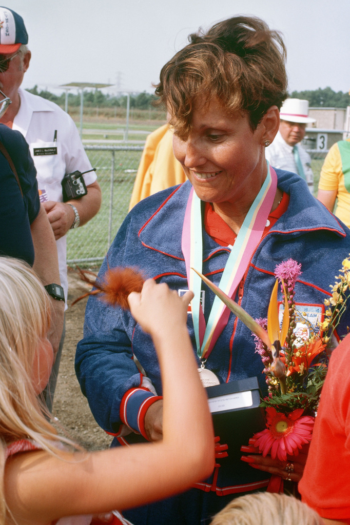 Army SPECIALIST 5 Ruby E. Fox, from Parker, Arizona, talks with a young spectator after receiving a silver medal in the sport pistol competition at the 1984 Summer Olympics
