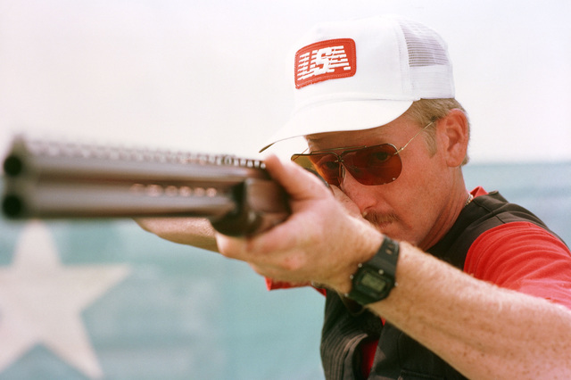 Army STAFF Sergeant Daniel T. Carlisle from Fort Benning, Georgia, participates in the trap shooting competition at the 1984 Summer Olympics. He won a bronze medal for his performance in the event