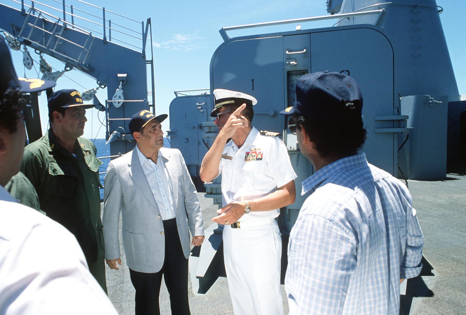 Captain Gerald E  Gneckow, commanding officer of the USS