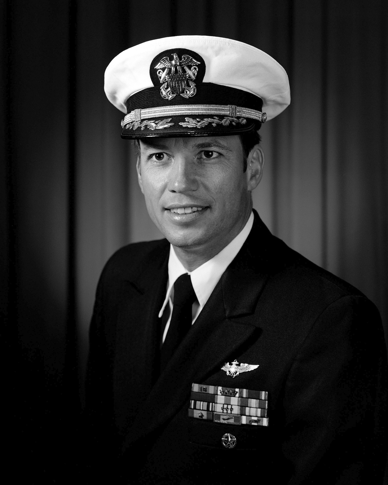 Commander James I. Maslowski, USN (covered)
