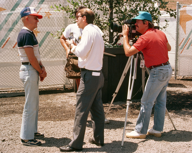 Joe Berry, left, US Army (Ret.) from Washington, DC, is interviewed for television during the 1984 Summer Olympics. He is the manager of the shooting team