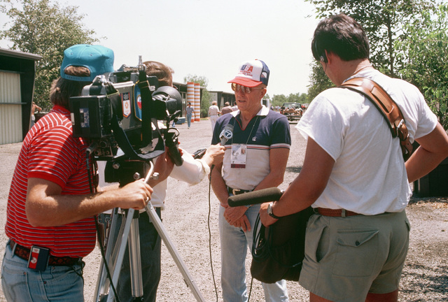 Joe Berry, US Army (Retired) from Washington, DC, is interviewed for television during the 1984 Summer Olympics. Mr. Berry is the manager of the shooting team