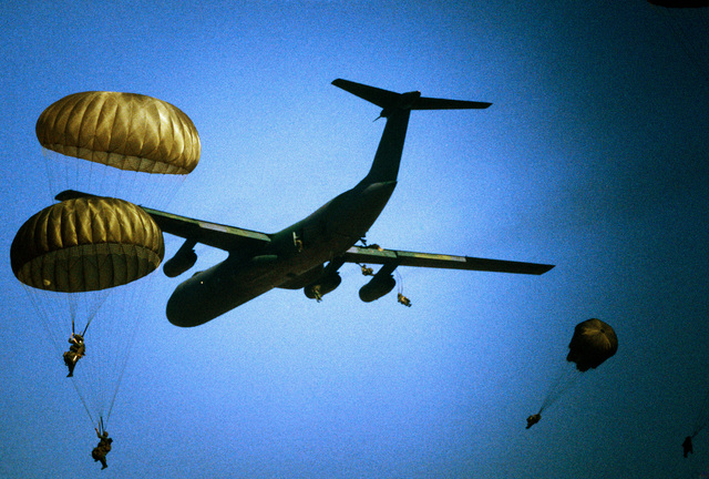 Paratroopers of the 82nd Airborne Division jump from a C-141B Starlifter aircraft over San Luis Obispo, California, during Exercise GALLANT EAGLE '84