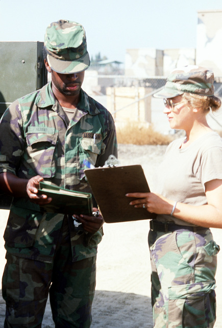 SPEC. 4 Albert Irvin, left, of the 173rd Transportation Company signs for fuel issued by PFC. Kathy Blankey at the petroleum oil lubricants issue point during exercise Gallant Eagle '84