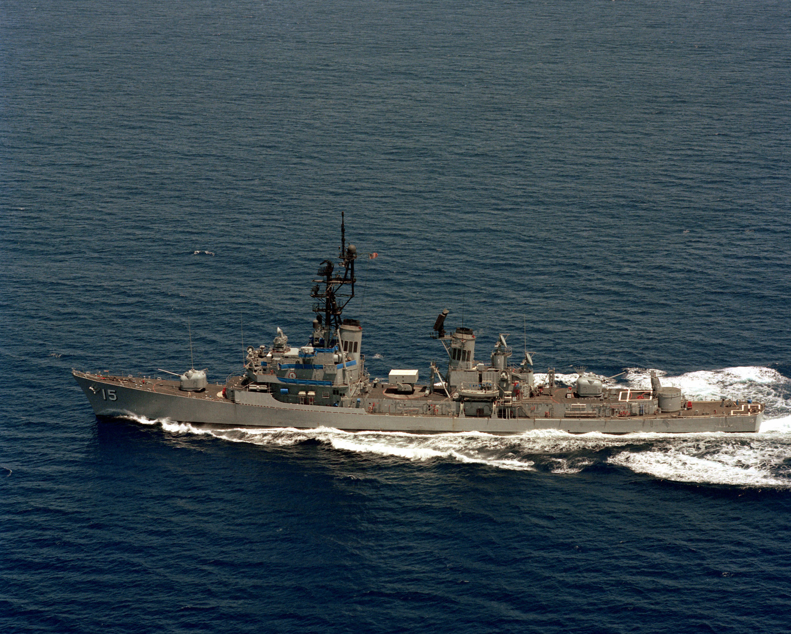 Aerial port beam view of the Charles F. Adams class guided missile destroyer USS BERKELEY (DDG 15) underway
