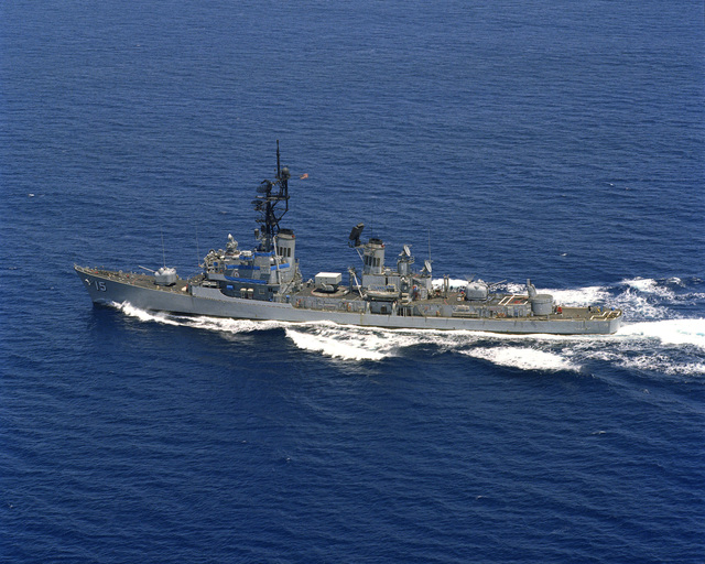 An aerial port view of the guided missile destroyer USS BERKELEY (DDG 15) underway