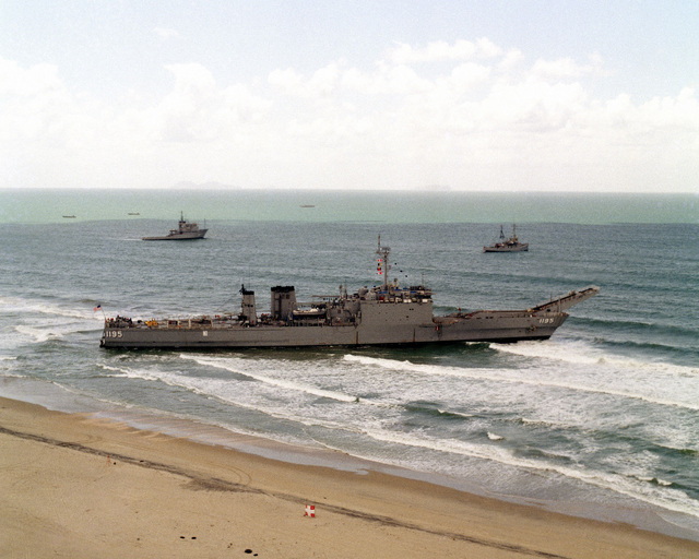 An aerial starboard view of the tank landing ship USS BARBOUR COUNTY (LST 1195) after running aground on Silver Strand