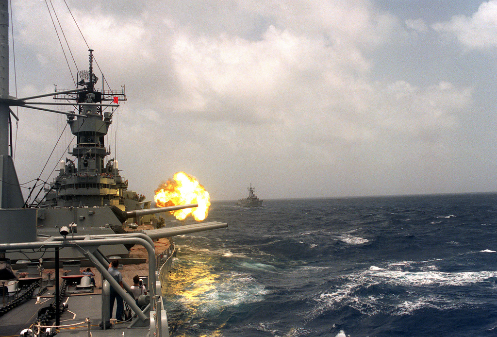 The USS IOWA (BB 61) 16-inch 50-cal  guns are fired off the