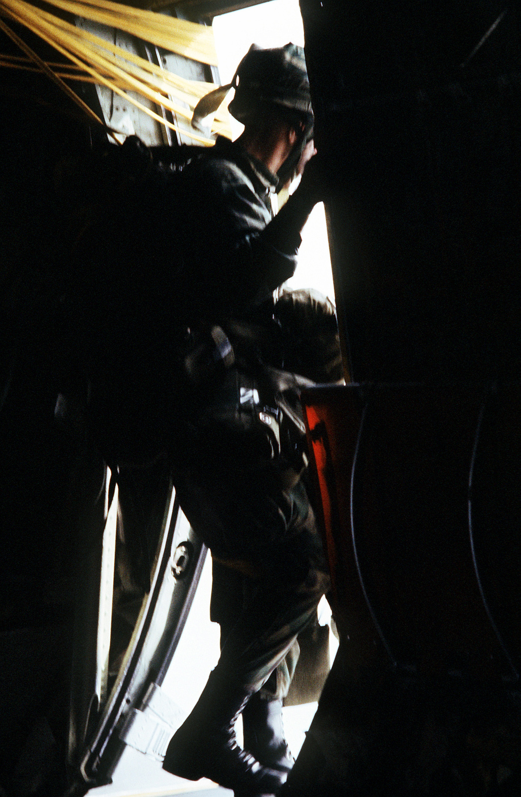 A member of the 509th Airborne Ranger Battalion prepares to jump from a 37th Tactical Airlift Squadron C-130 Hercules aircraft during an operational readiness exercise