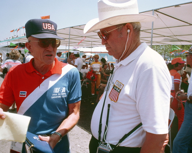 Army Lieutenant William Pullum, right, from Fort Benning, Georgia, a shooting team coach, talks with another shooting team advisor during competition at the 1984 Summer Olympics