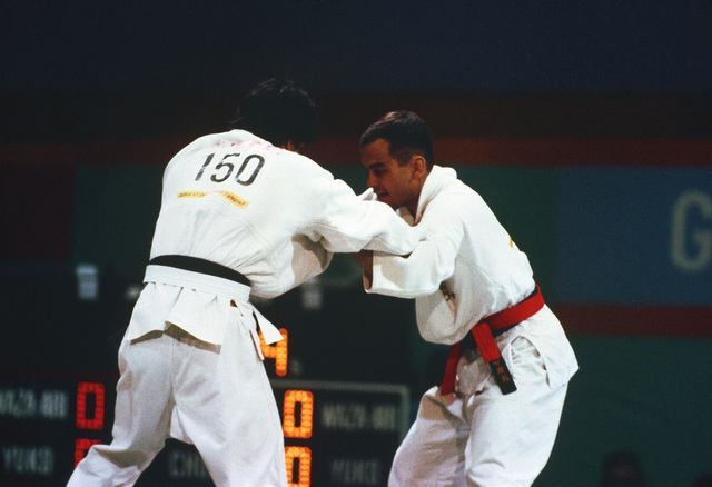 Army Second Lieutenant Craig Agena, right, competes in a judo match against Alfredo Chinchilla of Norway during the 1984 Summer Olympics