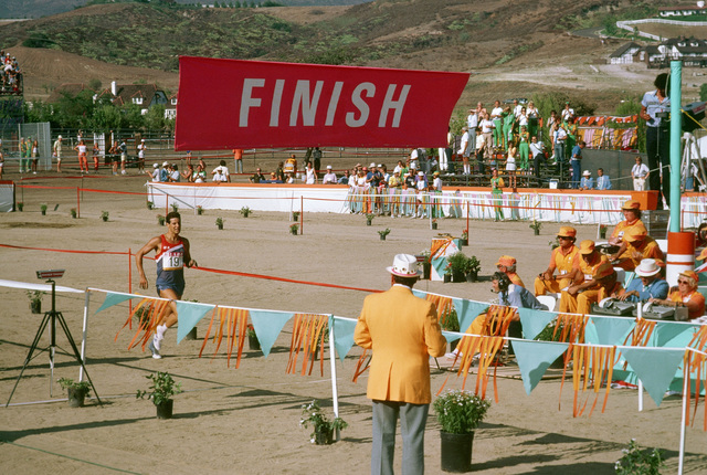 Army SPECIALIST 5 Dean W. Glenesk from Fort Sam Houston, Texas, crosses the finish line during the running phase of the Modern Pentathlon at the 1984 Summer Olympics. He won a silver medal for his performance in the event which also includes swimming, fencing, riding and shooting