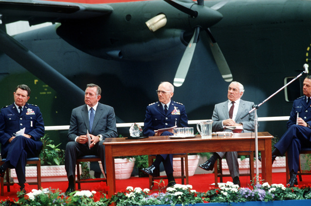 Seated on the platform during the presentation ceremony for the first C-23A Sherpa aircraft to the US are, from left to right, Major General William P. Acker, commander 3rd Air Force; Charles H. Price II, US ambassador to the Court of St. James; Lieutenant General Thomas H. McMullen, commander, Aeronautical Systems Division; Sir Philip Foreman, chairman and general manager Short Brothers; and Lieutenant General Carl H. Cahey, vice commander in chief, US Air Forces Europe