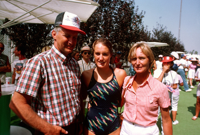 Army Colonel and Mrs. Edward G. Rapp stand with their daughter, Susan, center, a member of the swimming team competing at the 1984 Summer Olympics