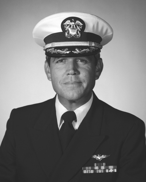 Commander (CDR) Eric L. Lekberg, USN (covered)