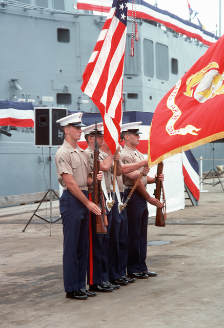 A Marine Corps color guard participates in the commissioning ceremony for the guided missile frigate USS ROBERT G. BRADLEY (FFG 49)