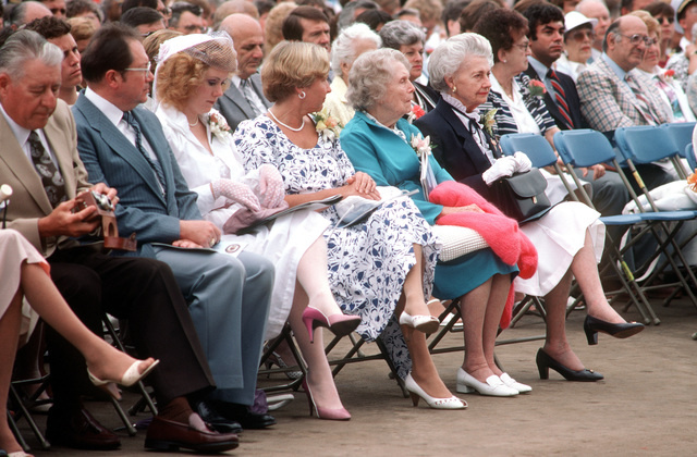 Mrs. Edna D. Woodruff, right, sponsor, sits with members of her family during the commissioning ceremony for the guided missile frigate USS ROBERT G. BRADLEY (FFG 49). Mrs. Woodruff is the mother of the ship's namesake who was killed during World War II