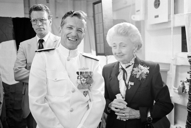 Vice Admiral (VADM) Joseph Metcalf III, commander, Second Fleet, stands with Mrs. Edna Woodruff at a reception following the commissioning of the guided missile frigate USS ROBERT G. BRADLEY (FFG 49). Mrs. Woodruff is the mother of the ship's namesake