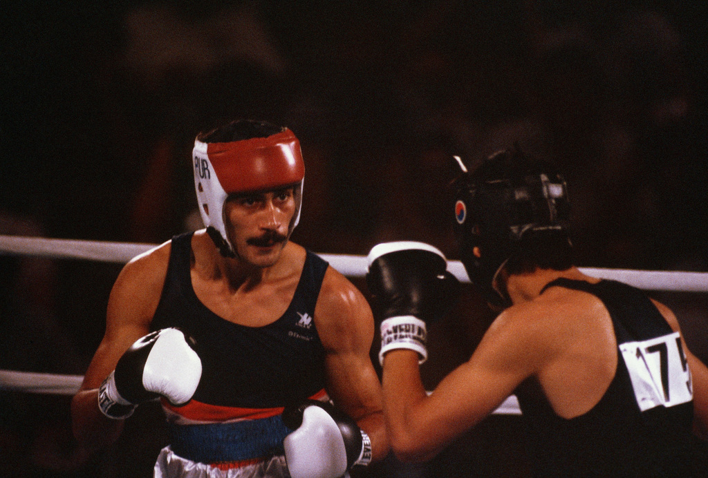 Army SPECIALIST Fourth Class Aristedes Gonzalez of Puerto Rico, left, boxes Joon-Sup Shin of South Korea during the 1984 Summer Olympics