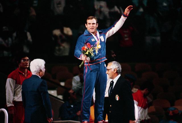 Edward Banach waves after receiving a gold medal in the 90 kg freestyle wrestling competition at the 1984 Summer Olympics. Banach is the twin brother of Army Second Lieutenant Ludwig Banach, also a member of the wrestling team