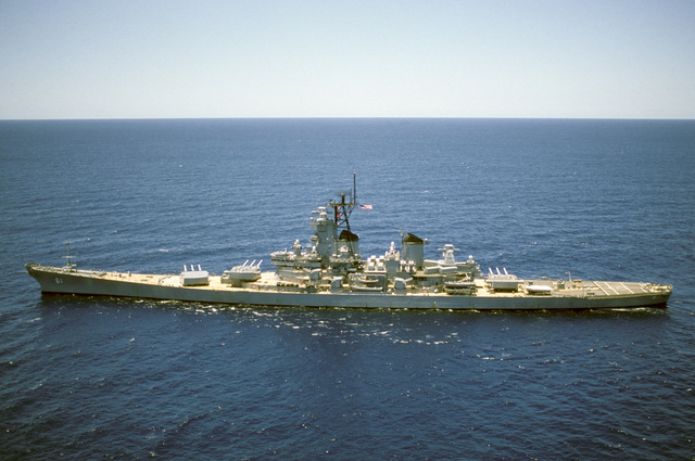 Aerial port beam view of the battleship USS IOWA (BB 61) operating off the coast of El Salvador