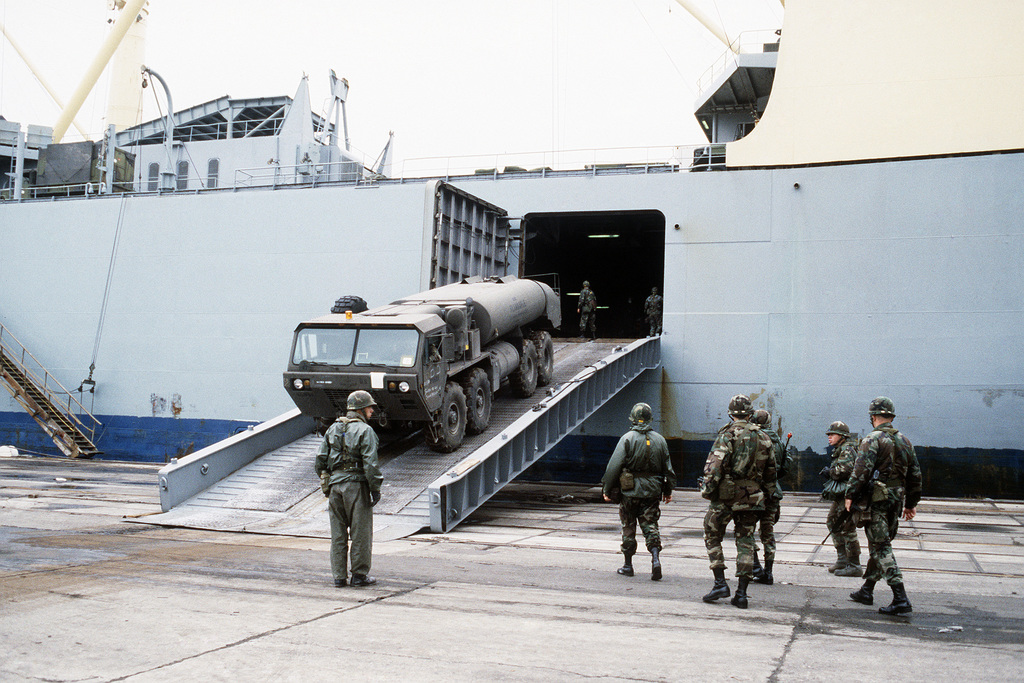 An M978 tactical fuel truck is offloaded from the vehicle cargo ship SS ADMIRAL WILLIAM M. CALLAGHAN (T-AKR 1001). The truck will be used in SPEARPOINT '84, a phase of Exercise REFORGER '84