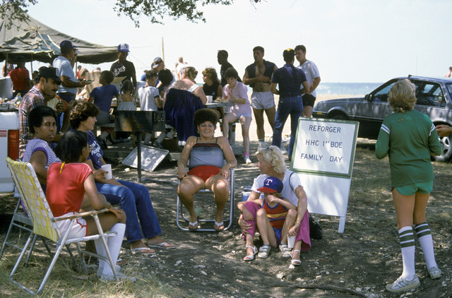 Members of Headquarters and Headquarters Co., 1ST Brigade, 2nd Armored Division, and their families attend a picnic at the conclusion of Reforger Family Day briefing. The unit is preparing to go to West Germany for SPEARPOINT '84, a phase of Exercise REFORGER '84