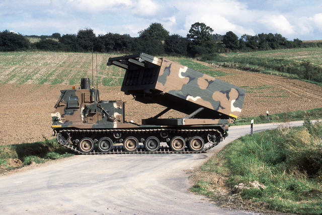 The missile pod of an M270 227 mm multiple launch rocket system from B Battery, 1ST Battalion, 92nd Field Artillery, is raised into the firing position during SPEARPOINT '84, a phase of Exercise REFORGER '84