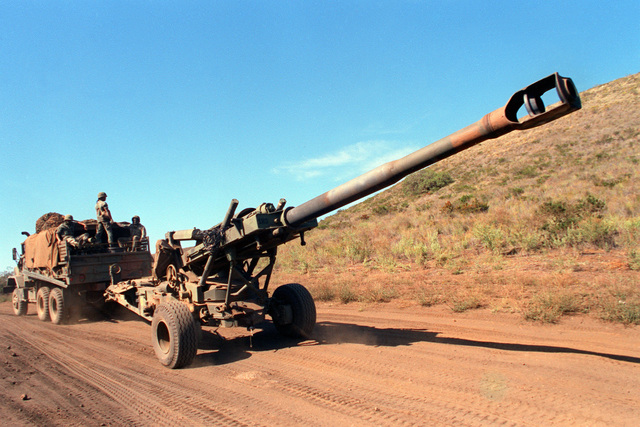 An M-198 155mm howitzer is towed to the Pohakuloa Training Area for a live-fire exercise conducted by the 1ST Bn., 8th Field Artillery, 25th Infantry Division