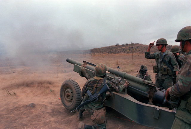 Members of B Battery, 7th Bn., 9th Field Arty. Regt., Inf. Div., fire a 105mm M-102 howitzer during a live-fire exercise at the Pohakuloa Training Area