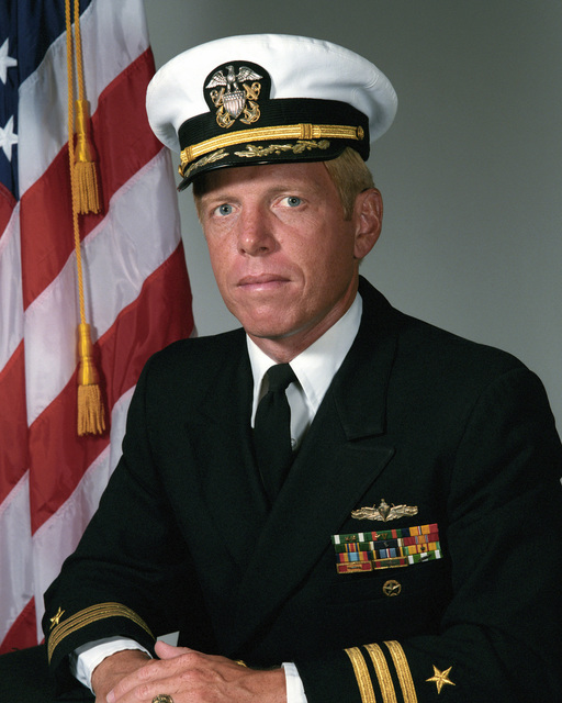 Commander (CDR) Thomas M. Daly, USN (covered)