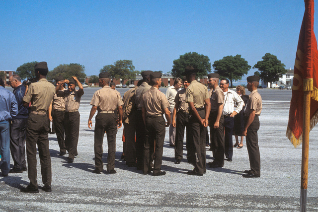 Graduates of recruit training greet friends and members of their families upon completion of ceremonies at the Marine Corps Recruit Depot