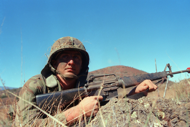 Private First Class (PFC) Tim R. Blanton of Company A, 5th Infantry, 25th Division, keeps is M16A1 rifle ready while on the lookout for opposing forces during Exercise OPPORTUNE JOURNEY 4-84
