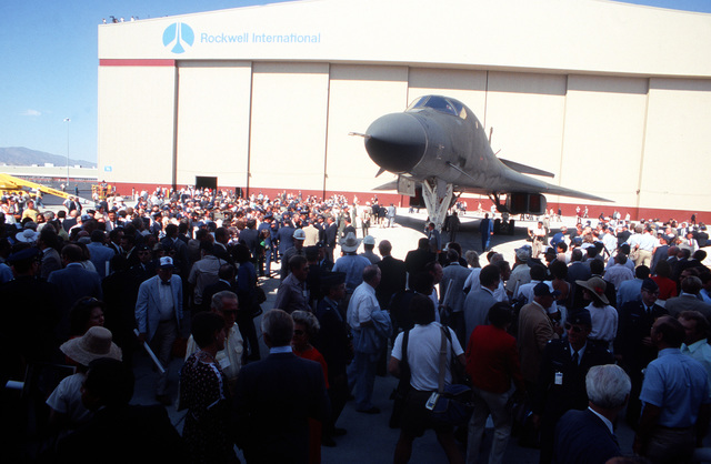 A crowd gathers to view the first production model B-1B aircraft during the rollout ceremony at the Rockwell International Corp. facility