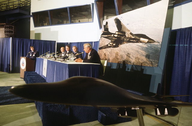Attending a news conference during the rollout of the first production model B-1B aircraft are, seated from left to right; Gerald Gimness, B-1 program manager, Boeing Military Airplane Co.; Ned A. Hope, general manager, F101 Project Department, General Electric Co.; Major General (MGEN) William Thurman, B-1B program manager, Wright-Patterson Air Force Base; and John L. Canfalone, vice president, B-1B program, Eaton Corp